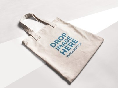 Angled Mockup of a Tote Bag Lying on a Multicolor Surface a15311