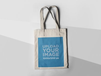 Tote Bag Mockup Lying on a Three Colors Surface a15312