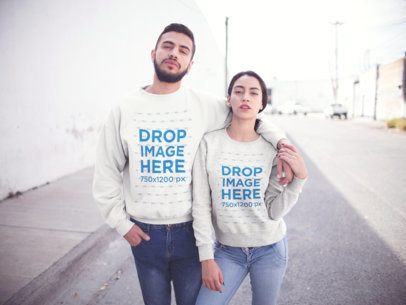 Young Hispanic Couple Walking in the City While Wearing Different Crewneck Sweatshirts Mockup a13431