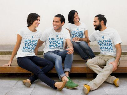 Group of Four Friends Chatting Wearing Different T-Shirts Mockup While Sitting Down a15461