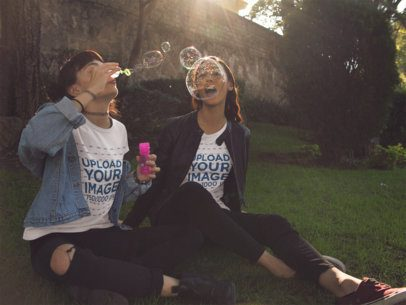 Two Girlfriends Playing With Bubbles While Wearing Different Tees Outdoors a13389