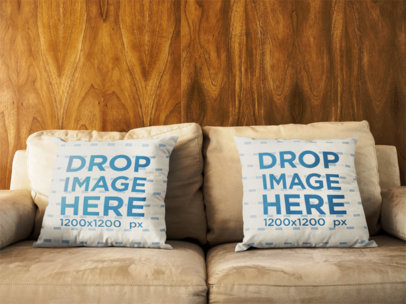 Pair of Pillows Mockup Lying on a Sofa Against a Wooden Wall a14928