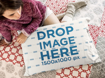 Top Shot of a Young Girl Holding a Pillow While Sitting Down on the Floor a14940