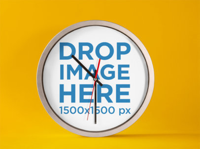 Round Clock Mockup Standing on a Solid Color Surface a15235