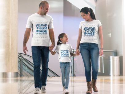 Father Mother and Daughter Walking at the Mall Wearing Different Tshirts Mockup a15672