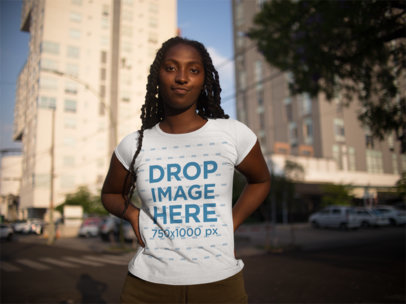 Black Girl About to Laugh Wearing a Tshirt Mockup While Standing in the Street a15548