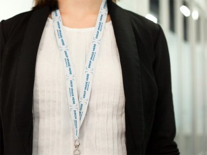 Office Girl Using a Lanyard Mockup While Standing With a Cropped Face a15152