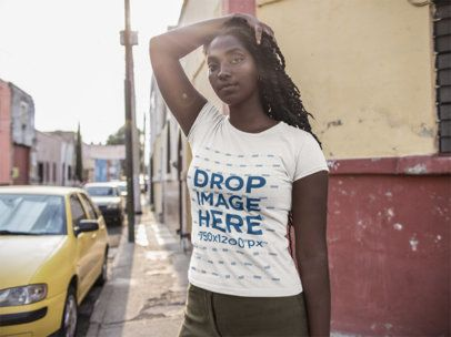 T-Shirt Mockup Being Worn by a Young Woman While on the Street a15563