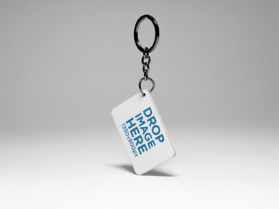 Keychain Template Standing About to Float Over a Solid Color Surface a15409