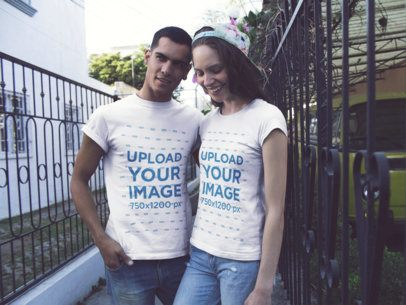 Young Couple Smiling While Wearing T-Shirts Mockup with Different Designs on the Street a15789