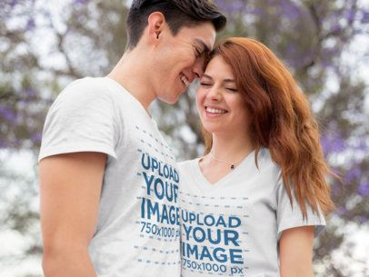 Romantic Young Couple Wearing a Round Neck and a V-Neck Tshirt Mockup while Outdoors a15736