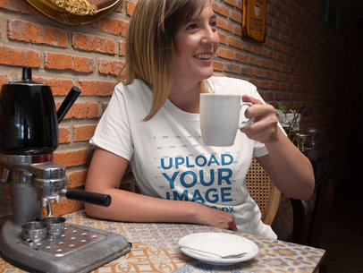 Smiling Middle Aged White Woman Wearing a Tee Mockup While Drinking a Coffee a15775