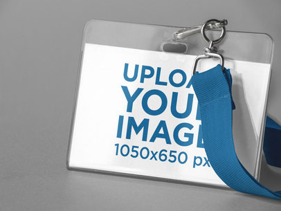 Closeup of a Badge Holder Mockup Standing Against a Solid Color Background a15230