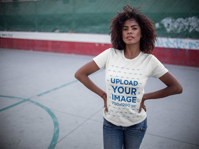 Mockup of a Black Girl Wearing a Round Neck Tee While at a Basketball Court a15817