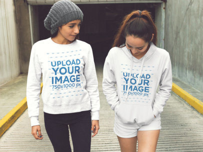 Mockup of Two Girls Coming Out of a Tunnel Wearing a Crewneck Sweatshirt and a Pullover Hoodie a15739