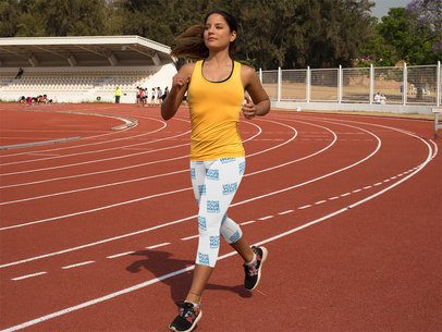 Track and Field Uniforms - Beautiful Girl Running on a Track While Wearing Leggings Mockup a15321