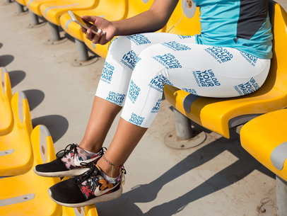 Mockup of a Girl Wearing Leggings While Using her Cellphone in a Stadium a15322