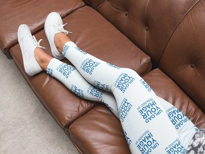 Leggings Mockup Being Worn by a Girl Lying on a Leather Sofa a15709