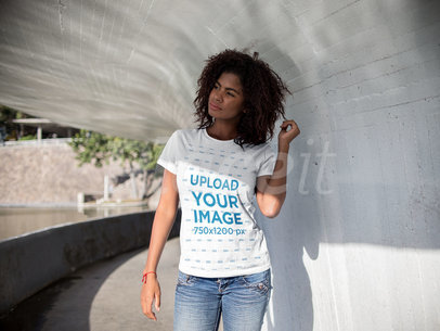 Young Black Girl Holding her Hair Under a Tunnel While Wearing a Round Neck T-Shirt Template a15810