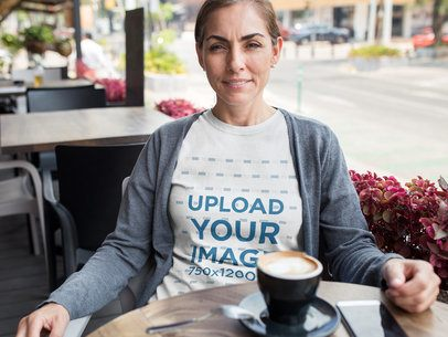 Middle Aged Woman Wearing a Round Neck T-Shirt Mockup While at a Cafe a15866