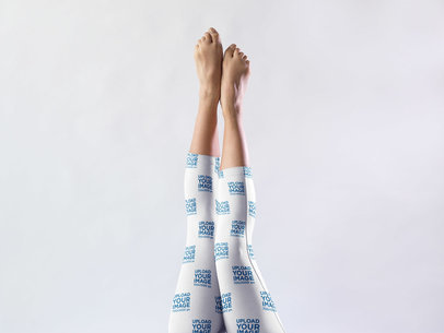 Extended Legs Against a White Background Wearing Short Leggings Mockup a15400