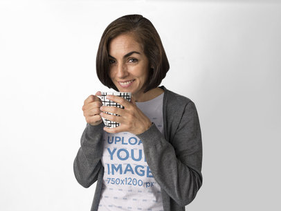 Smiling Hispanic Woman Wearing a Tee Mockup While Holding a Cup of Coffee a15861