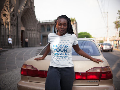 Girl with Dreadlocks Wearing a Round Neck Tee Mockup While Lying Against an Old Car a15951