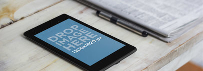 Nexus 7 Black Portrait Next To Newspaper Wide