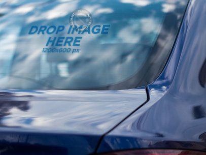 Mockup of a Decal on the Back Window of a Blue Car a15348