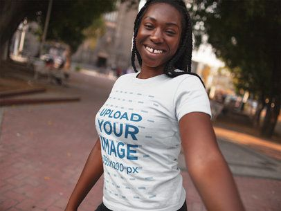 Smiling Black Girl with Dreadlocks Wearing a Tshirt Template While Taking a Walk a15955