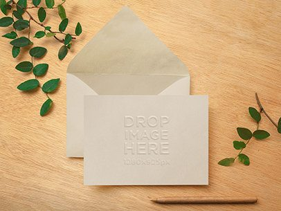 Envelope Mockup Featuring an Open Envelope on Top of a Wooden Desk a6531