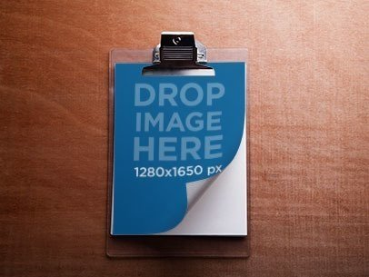 Mockup of a Clipboard Lying on Top of a Wooden Surface a6219