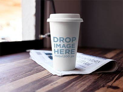 Label Mockup Featuring a Coffee Cup Standing on Top of a Newspaper a6970