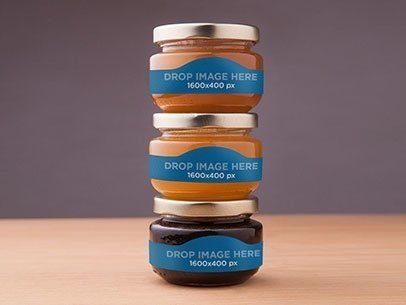 Label Mockup Featuring Three Jars of Honey On Top of a Wooden Surface a6635