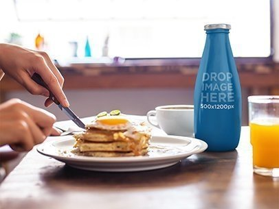 Label Mockup Featuring a Juice Bottle at a Breakfast Table a7015