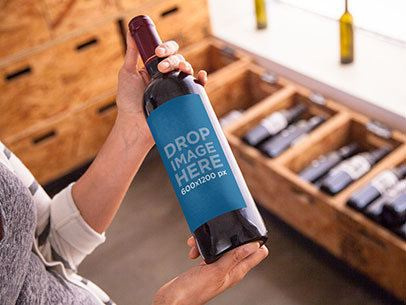 Mockup Featuring a Woman Holding a Wine Bottle a6701