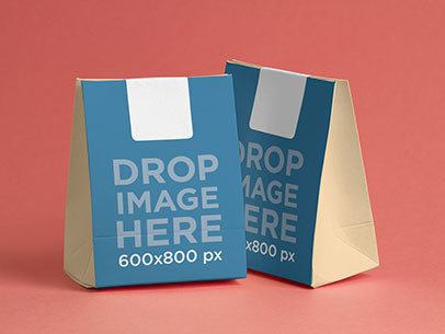 Paper Bag Mockup Featuring Two Paper Bags Over a Flat Surface a6771