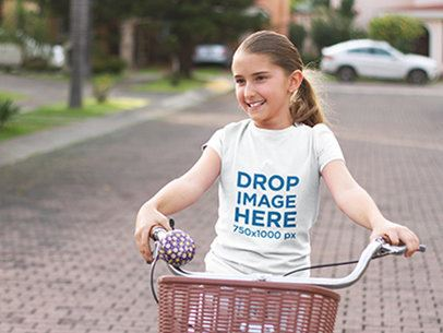 T-Shirt Mockup Featuring a Young Girl Riding a Bicycle a7939