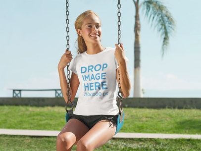 T-Shirt Mockup Featuring a Beautiful Girl on a Swing a7806