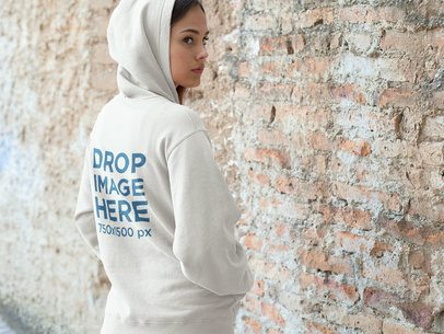 Hoodie Mockup of a Woman Standing in Front of a Brick Wall a7881