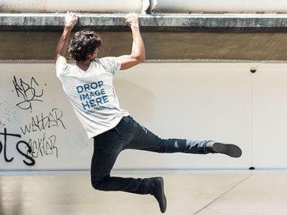 Back Shot of a Man Hanging From a Bridge T-Shirt Mockup a6087