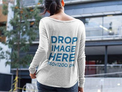 Mockup of a Girl Wearing a Long Sleeve Tee While on the Street a9745b