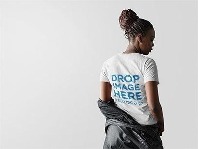 Back Shot of a Girl with Dreadlocks Wearing a Tshirt Mockup Carrying a Jacket a9841b