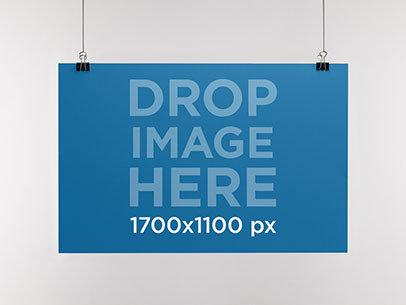 Mockup Template of a Paper Poster Hanging From a Wall a10328
