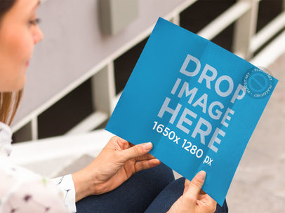 Brochure Mockup Featuring a Woman Sitting on a Stairway a10320