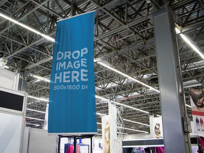 Vertical Banner Mockup Hanging From a Ceiling at a Convention Center a10685