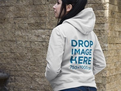 Back Shot of a Woman Wearing a Pullover Hoodie Mockup on a Stone Staircase a9414b