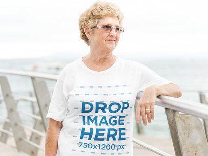 T-Shirt Mockup of an Elderly Woman in an Outdoor Environment a10935