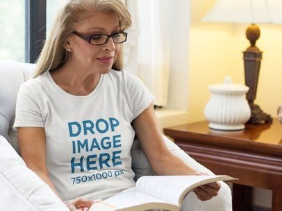 T-Shirt Mockup of a Middle-Aged Woman Reading in Her Home a11367