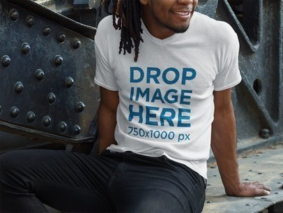 V-Neck T-Shirt Mockup of a Smiling Black Man With Dreadlocks Sitting a8755